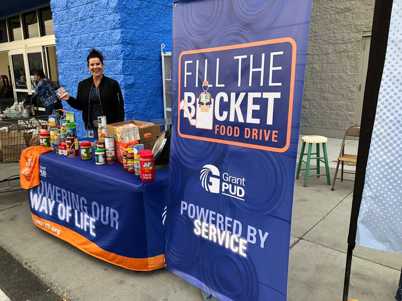 "Grant PUD employee collecting food for our ""Fill the Bucket"" food drive"